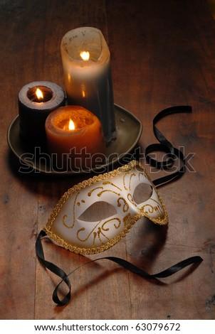 Beautiful Venetian mask   on a table - stock photo