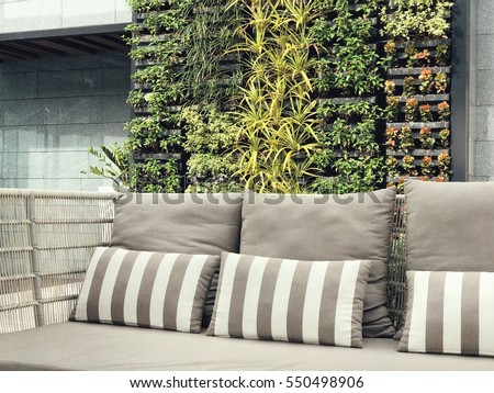 Shutterstock Beautiful vertical garden with outdoor sofa for family relaxing zone