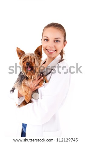 Beautiful veterinarian with dog