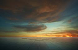 Beautiful vibrant orange cloud and blue sunset sky with empty asphalt floor .