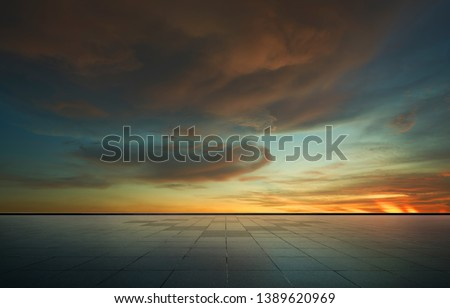 Beautiful vibrant orange cloud and blue sunset sky with empty asphalt floor . #1389620969