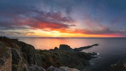 Beautiful vibrant sunset over a dramatic rugged coastline. Long Point Twillingate, Newfoundland Canada