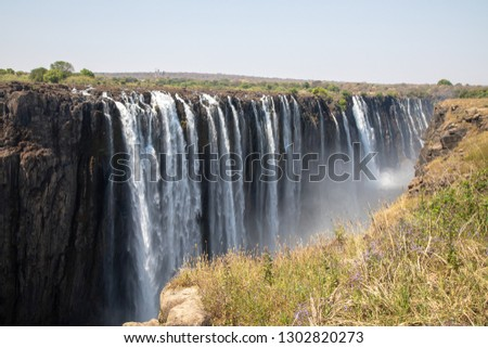 Beautiful Victoria Falls in Sambia and Simbabwe, Southern Africa during dry season #1302820273