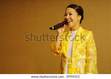 Beautiful Vietnamese-American bride with a microphone on her wedding day; plenty of copy space included