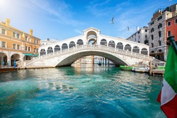 Beautiful view from the Canal Grande to the famous Rialto Bridge in Venice, Italy, without people and clear, emerald water