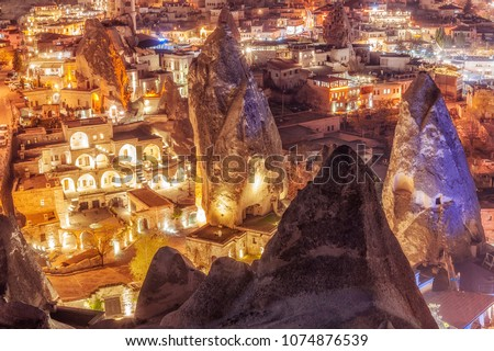 Beautiful view Goreme, Cappadocia, Turkey at night. Famous center of balloon fligths. #1074876539