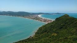 Beautiful view of a beach with greenish sea in Bombinhas, Santa Catarina - Brazil.