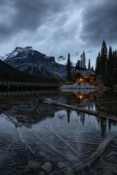Beautiful view of a cabin near a glacier lake with Canadian Rocky Mountains in the background. Taken in Emerald Lake, British Columbia, Canada.