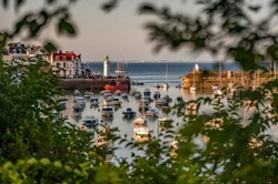 beautiful view of a harbour at sunset in Brittany, France