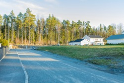 Beautiful view of a village road and private cottage houses. Sweden.