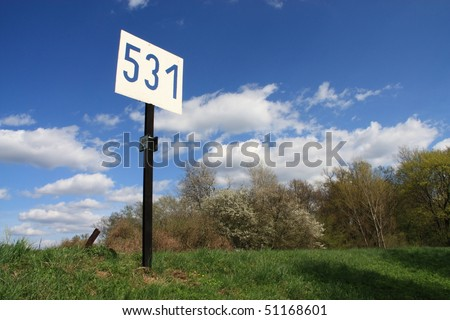 Beautiful view of bike sign with cloud filled sky.