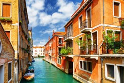 Beautiful view of colorful facades of old houses and the Rio Marin Canal from the Ponte de la Bergami in Venice, Italy. Venice is a popular tourist destination of Europe.