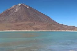 Beautiful view of colorful Laguna Verde, green lagoon lake, in scenic mountain landscape in bolivian Altiplano at latin Eduardo Avaroa Andean Fauna National Reserve in Bolivia, South America.