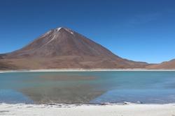 Beautiful view of colorful Laguna Verde, green lagoon lake, in scenic mountain range landscape in bolivian Altiplano at latin Eduardo Avaroa Andean Fauna National Reserve in Bolivia, South America.