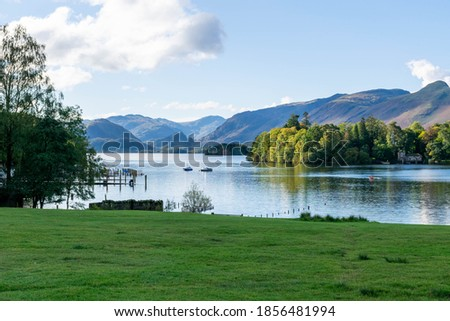 Photo of  Beautiful view of Derwentwaterin the quaint market town of Keswick in the Lake District, England UK. The lake is three miles long and is fed by the River Derwent. No people. Pure natural beauty.
