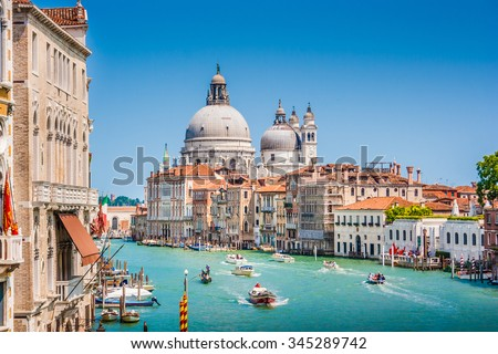 Beautiful view of famous Canal Grande with Basilica di Santa Maria della Salute in the background on a sunny day in summer, Venice, Italy #345289742