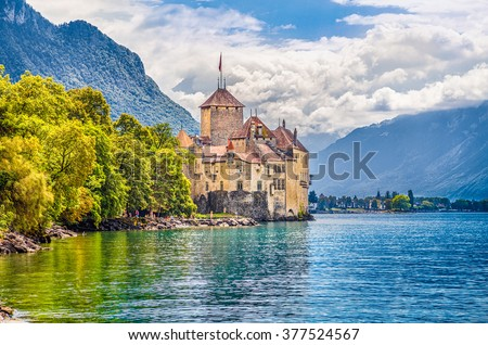 Beautiful view of famous Chateau de Chillon at Lake Geneva, one of Switzerland\'s major tourist attractions and most visited castles in Europe, with blue sky and clouds, Canton of Vaud, Switzerland