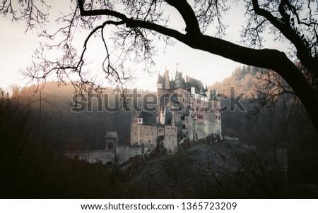 Beautiful view of famous Eltz Castle in scenic golden morning light at sunrise in fall, Wierschem, Rheinland-Pfalz, Germany stock photo