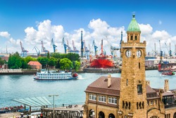 Beautiful view of famous Hamburger Landungsbruecken with harbor and traditional paddle steamer on Elbe river, St. Pauli district, Hamburg, Germany