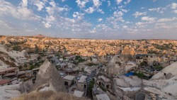 Beautiful view of Goreme from viewpoint aerial timelapse, Cappadocia, Turkey during sunrise. Famous center of balloon fligths. Cloudy blue sky