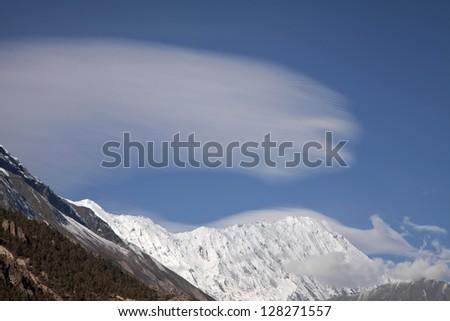 Beautiful view of Himalayan mountains over Manang village, Annapurna Region, Nepal - stock photo