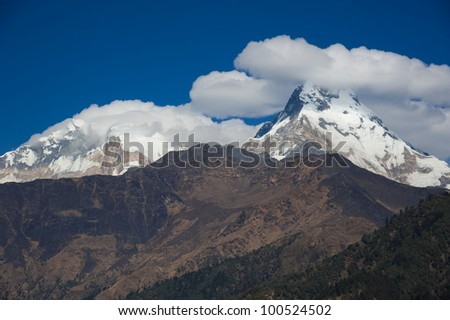 Beautiful view of Himalayan mountains with snow in morning when see from Ghorepani Village, Poon Hill Trekking way, Nepal
