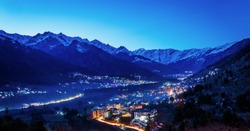 Beautiful View of Himalayas mountains and manali city after sunset in Manali,India Himachal. Long Exposure
