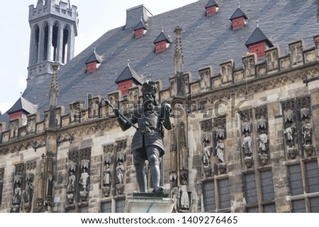 Beautiful View Of Historical Aachen City. Historic Highlights of Germany. Brown And White Background.