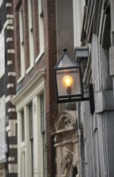 Beautiful View Of Historical Amsterdam City And Street Light. White And Brown Geometric Pattern.