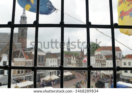 Beautiful View Of Historical Gouda Town Out Of The Window. Historic Highlights Of The Netherlands. Dark And Light Background.