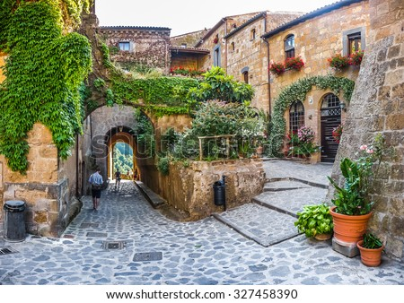 Beautiful view of idyllic alley way in famous Civita di Bagnoregio near Tiber river valley, Lazio, Italy