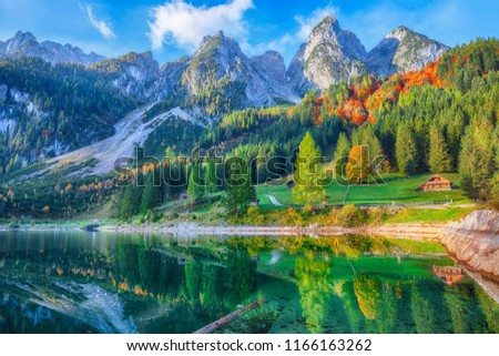 Beautiful view of idyllic colorful autumn scenery with Dachstein mountain summit by Gosausee mountain lake in fall Salzkammergut region Upper Austria Austria #1166163262