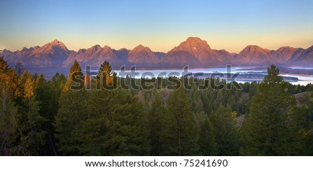 Beautiful view of Jackson Lake and the Grand Teton Mountains at sunrise from Signal Mountain. Grand Teton National Park, Wyoming, United States.