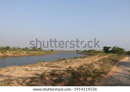 Beautiful view of Landscape Arani river and blue sky background near kadapakkam village, ponneri, Thiruvallur District, Tamil Nadu in India Stock fotó ©