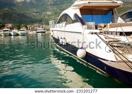 Beautiful view of luxurious white yacht moored at sea bay