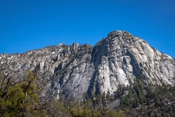 Beautiful view of majestic Tahquitz Peak on a clear sunny spring day with patches of snow remaining from the winter, Devils Slide Trail, San Jacinto Wilderness, Idyllwild-Pine Cove, California