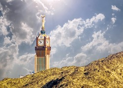 Beautiful view of Makkah Tower, Clock Tower top view and dry mountains of holy city of Makkah, Saudi Arabia
