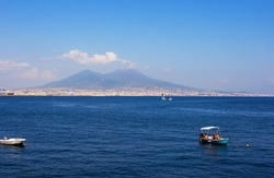 Beautiful view of Mount Vesuvius from the hill near embankment in Naples, Campania, southern Italy.