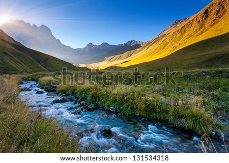 Beautiful view of mountain river in summer. Juta village - foot of Mt Chaukhebi. Georgia, Europe. Caucasus mountains. Beauty world. #131534318