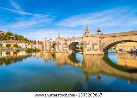 Beautiful view of old main bridge of Wurzburg with reflection in the river. Germany