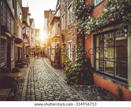 stock photo beautiful view of old town in europe in beautiful golden evening light at sunset in summer with 334956713 - Каталог — Фотообои «Улицы, переулки»