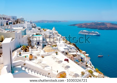 Beautiful view of picturesque town of Thira, caldera and volcano on the Mediterranean Sea. Traditional white architecture of the island of Santorini, Greece.