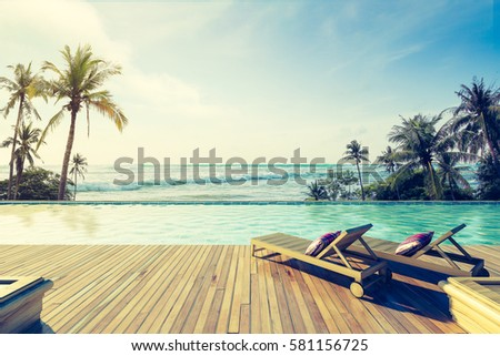 Beautiful view of Swimming Pool with  the sea at sunlight ,Vintage Tone - 3d rendering #581156725