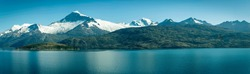 Beautiful view of the Chilean Fjords region in south Patagonia in Chile. Cruise ship sailing the Glacier Alley from the Beagle channel to the Pacific Ocean. Incredible view of the high mountains