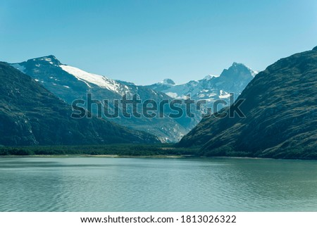 Beautiful view of the Chilean Fjords region in south Patagonia in Chile. Cruise ship sailing the Glacier Alley from the Beagle channel to the Pacific Ocean. Incredible view of the high mountains stock photo