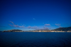 Beautiful view of the city in the horizont from ferry between north and south island in New Zealand, sailing into Picton