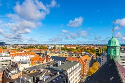 Beautiful view of the Copenhagen from top on round tower in warm sunny clear autumn weather, scenic Copenhagen cityscape in the fall, Denmark