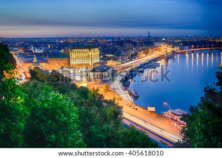 Beautiful View of the Dnieper river, River station, Havana bridge and Naberezhno-Kreschatitska street in Kiev, Ukraine. Night panorama of Kyiv