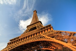 Beautiful view of the Eiffel tower seen from beneath in the golden hour in Paris
