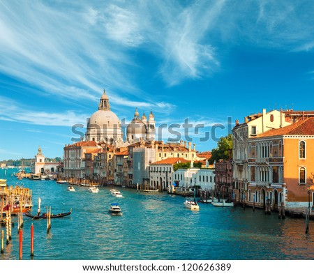 Beautiful view of the Grand Canal and Basilica Santa Maria della Salute in the late evening with very interesting clouds, Venice, Italy #120626389